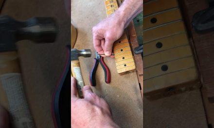 Refretting a maple board Fender neck!