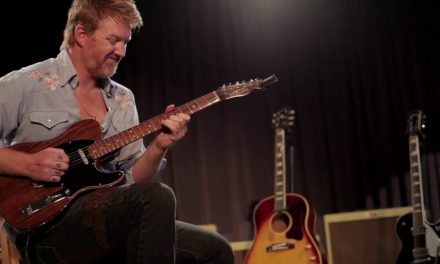 Josh Homme playing George Harrison's Telecaster